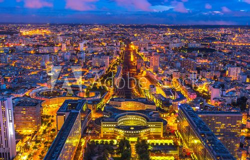 Fototapeta Aerial view of Gare Montparnasse illuminated by blue hour from panoramic Tour Montparnasse. Paris urban cityscape. Parisian style architecture of France in Europe. Night scene.