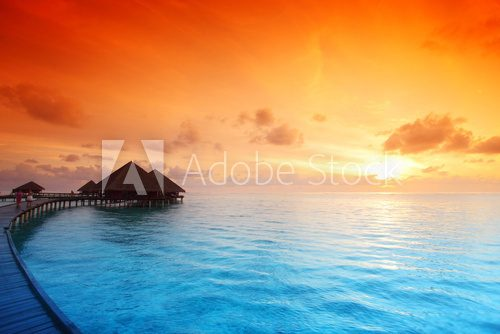 Fototapeta maldivian houses on sunrise