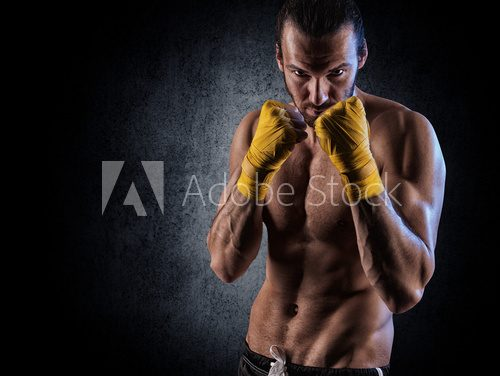 Fototapeta man wearing boxing gloves