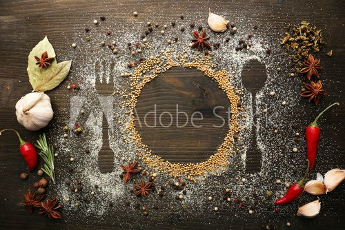 Fototapeta Spices on table with cutlery silhouette, close-up