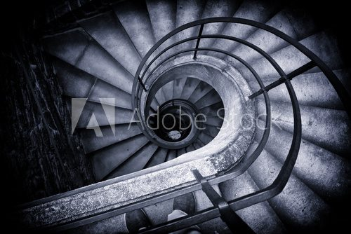 Fototapeta Spiral Staircase Winding Down in Historic Building