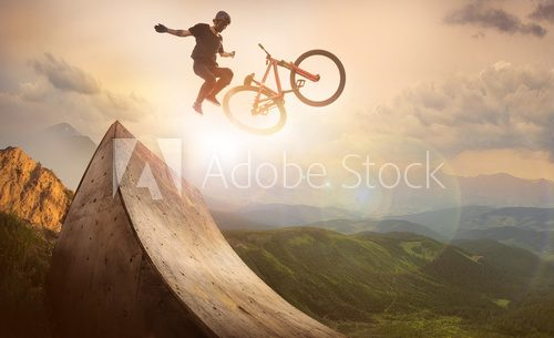 Fototapeta Sport. Motion biker jumps