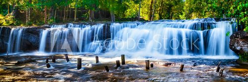 Fototapeta Tropical waterfall in jungle with motion blur